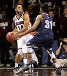 SIOUX FALLS, SD: MARCH 22: Tyler Jenkins #14 of Bellarmine holds the ball away from Colorado Mines defender Gokul Natesan #31 during the Men's Division II Basketball Championship Tournament on March 22, 2017 at the Sanford Pentagon in Sioux Falls, SD. (Photo by Dick Carlson/Inertia)
