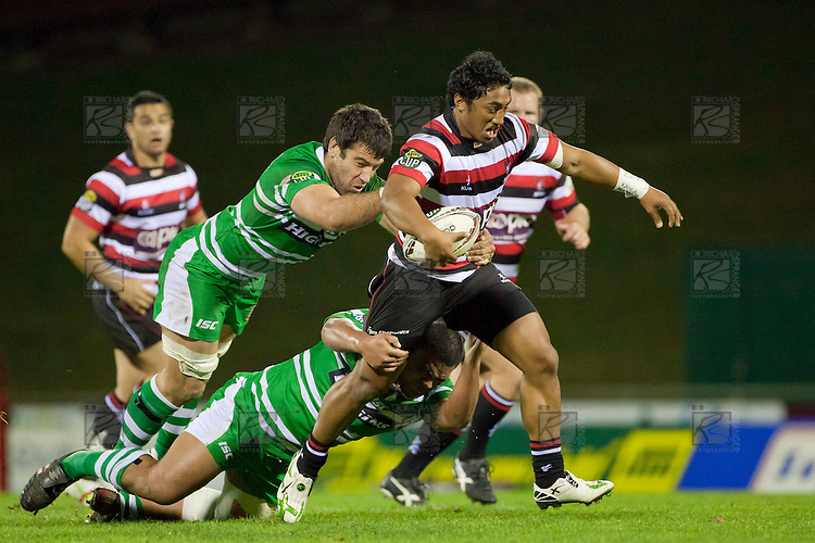 Bundee Aki tries to break away from tacklers Nick Crosswell and Ma'afu Fia. ITM Cup Championship Division Round 2 rugby game between Counties Manukau Steelers and Manawatu, played at Bayer Growers Stadium Pukekohe, on Wednesday July 20th 2011. Counties Manukau won the game 32 - 25 after leading 19 - 18 at halftime.