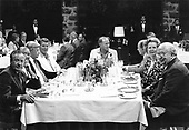 G-7 leaders attend an indoor bar-b-que at the Chateau Montebello in Montebello, Quebec, Canada on July 20, 1981. From left to right: President Gaston Thorn of the European Commission, Prime Minister Zenko Suzuki of Japan, Chancellor Helmut Schmidt of West Germany, United States President Ronald Reagan, Prime Minister Pierre Elliott Trudeau of Canada, President François Mitterrand of France, Prime Minister Margaret Thatcher of the United Kingdom, and Prime Minister Giovanni Spadolini of Italy. Inclement weather forced the meal to be moved indoors.<br /> Credit: Arnie Sachs / CNP