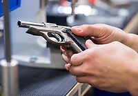 NWA Democrat-Gazette/BEN GOFF @NWABENGOFF<br /> Martin Salazar demonstrates the assembly and testing of a Walther PPK pistol Friday, Jan. 4, 2019, at Walther Arms in Fort Smith.