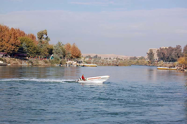 IRAQ, MOSUL:  A man drives a motor boat on the Dijla river in Mosul...Photo by Bashar Adnan/Metrography