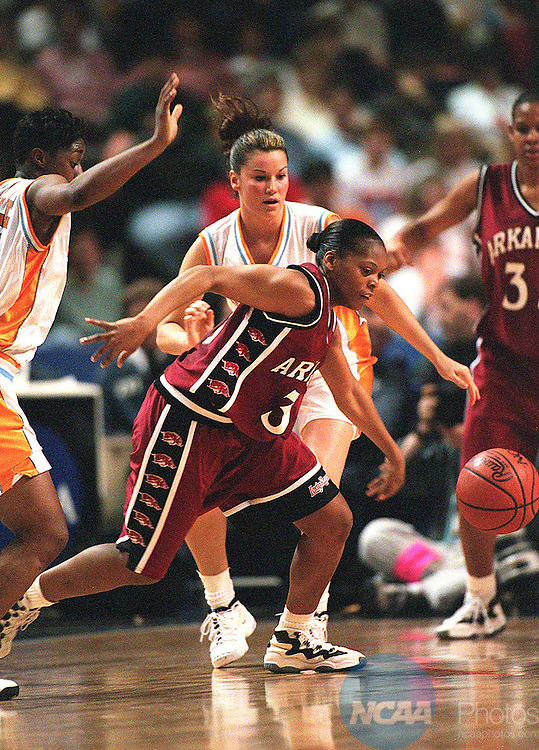 Caption: 27 MAR 1998: Guard Sytia Messer (30) of the University of Arkansas tries to gain control of a loose ball in front of guard Kristen Clement (33) of the University of Tennessee during the Division I Women's Basketball Semi-Finals held at Kemper Arena in Kansas City, MO. The University of Tennessee went on to defeat the Lady Razorbacks of Arkansas and advance to the finals. Ryan McKee/NCAA Photos