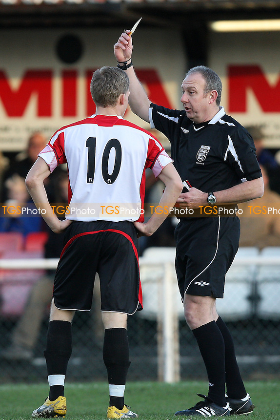 Lewis Smith of Hornchurch receives a yellow card from referee Tomlinson - AFC Hornchurch vs Lowestoft Town - Ryman League Premier Division Football at the Stadium - 02/01/12 - MANDATORY CREDIT: Gavin Ellis/TGSPHOTO - Self billing applies where appropriate - 0845 094 6026 - contact@tgsphoto.co.uk - NO UNPAID USE.