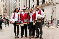 U.S. women national team midfielder Carli Lloyd, New York Red Bulls General Manager Jerome de Bontin, U.S. Soccer president Sunil Gulati, and former U.S. Men's National Team star Jeff Agoos pose for a photo outside the NYSE during the centennial celebration of U. S. Soccer at the New York Stock Exchange in New York, NY, on April 02, 2013.