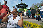 "Maira Bondejas sits in the Plaza Benito Juarez in Nuevo Laredo, Mexico, on March 3, 2017. She left her home in Cuba bound for the United States, but is now waiting close to the U.S.-Mexico border, caught in limbo by the elimination in January of the infamous ""wet foot, dry foot"" policy of the United States. She and other Cuban refugees are not allowed to enter the U.S. yet don't want to return to Cuba. Many of the city's churches have become temporary shelters for the immigrants, and congregations rotate responsibility for feeding the Cubans. Such solidarity from ordinary Mexicans is being tested these days, as not only are the Cubans stuck at the border, but the U.S. has stepped up deportations of Mexican nationals, while at the same time detaining many undocumented workers from other nations and simply dumping them on the US-Mexico border."