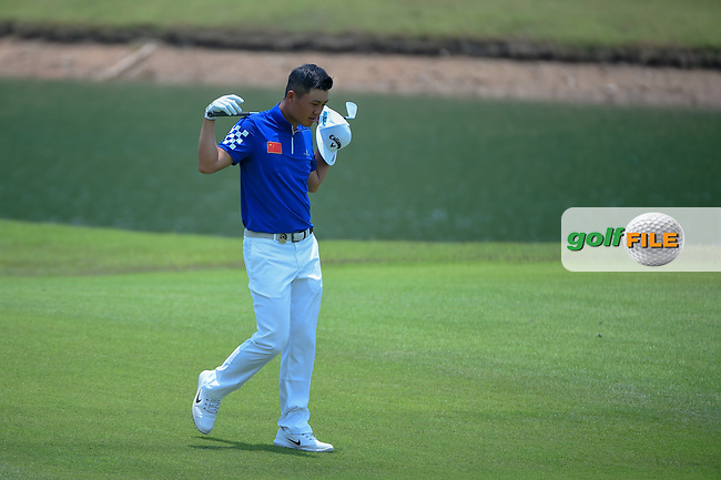 Yuxin LIN (CHN) heads down 5 after hitting from the fareway bunker during Rd 2 of the Asia-Pacific Amateur Championship, Sentosa Golf Club, Singapore. 10/5/2018.<br /> Picture: Golffile   Ken Murray<br /> <br /> <br /> All photo usage must carry mandatory copyright credit (© Golffile   Ken Murray)