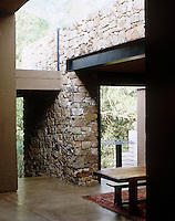 The walls of the house are built from stone mined from the land on which the house has been constructed