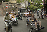 Hanoi-Vietnam, Ha Noi - Viet Nam - 21 July 2005---Two-wheel traffic and transport of tourists in a cyclo at the Old Quarter ---tourism, traffic, transport---Photo: Horst Wagner/eup-images
