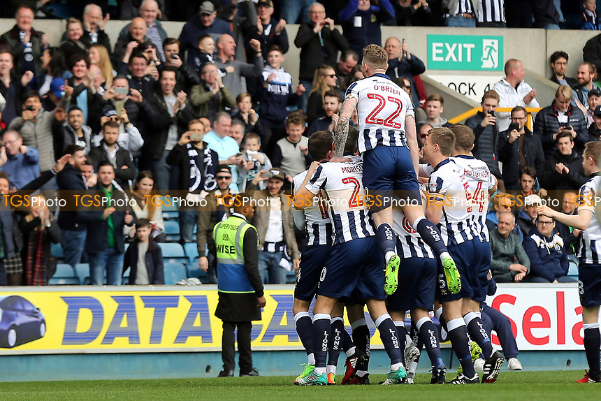 Millwall celebrate their opening goal scored by Shaun Williams during Millwall vs Scunthorpe United, Sky Bet EFL League 1 Football at The Den on 1st April 2017