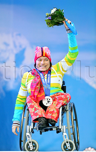 14.03.2014. Sochi, Russia.  Anna Wicker of Germany celebrates her Silver Medal in the Women's 12.5km - Sitting Biathlon event in Laura Cross-country Ski & Biathlon Center at the Sochi 2014 Paralympic Winter Games, Krasnaya Polyana, Russia, 12 March 2014.