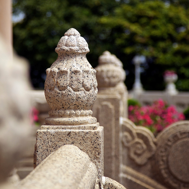 Art-work on a stone balustrade.
