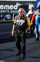 Feb. 17 2012; Chandler, AZ, USA; Crew chief Roland Leong watches driver Tim Boychuk make an exhibition run in his nostalgia funny car at the Arizona Nationals at Firebird International Raceway. Mandatory Credit: Mark J. Rebilas-
