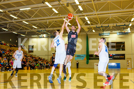 Dan Griffin Scotts Lakers gets his shot in over Mark Cannon Donegal during their game in Killarney Saturday night