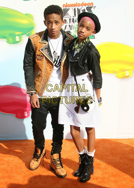 Jaden Smith, Willow Smith.2012 Nickelodeon Kids' Choice Awards held at the Galen Center, Los Angeles, California, USA, 31st March 2012..full length brother sister family siblings pink hair ying yang sign bag boots white dress  black brown leather jacket  hat .CAP/ADM.©AdMedia/Capital Pictures.