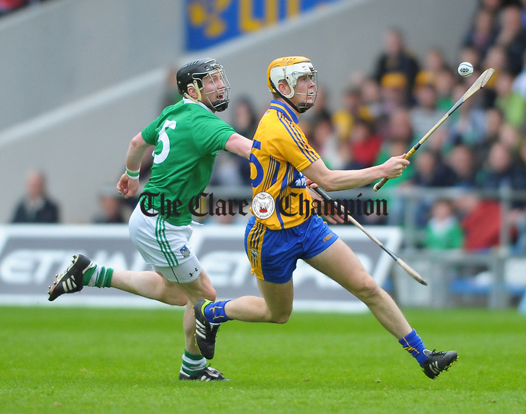 Aaron Cunningham of Clare in action against Wayne Mc Namara of Limerick during their game at Semple Stadium. Photograph by John Kelly.