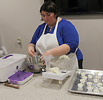 "Kaela Creonte, one of two bakers at Whisker Bones, prepares ""pupcake"" icing. The dog-friendly organic ingredients the company uses contain no preservatives or additives."