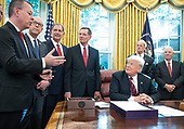 Pastor Andrew Brunson, left, makes a statement after United States President Donald J. Trump signed S.3021, America's Water Infrastructure Act of 2018 in the Oval Office of the White House in Washington, DC on Tuesday, October 23, 2018.  After signing the bill, the President took questions from the pool on the caravan and Saudi Arabia.  Also pictured from left to right: US Representative Greg Walden (Republican of Oregon), US Senator John Boozman (Republican of Arkansas), US Senator John Barrasso (Republican of Wyoming), US Senator Tom Carper (Democrat of Delaware), and US Senator Ben Cardin (Democrat of Maryland)<br /> Credit: Ron Sachs / Pool via CNP