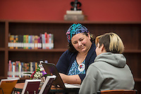 STAFF PHOTO ANTHONY REYES &bull; @NWATONYR<br /> Phyl Campbell, author, left, talks with Jordan Thompson, 12, seventh grader at Sonora Middle School Monday, Dec. 15, 2014 about a story she has written in the school's library in Springdale. Sixth and seventh graders have been writing stories that will be published through the school for the community, friends and family to read. The authors were available to help edit their work.