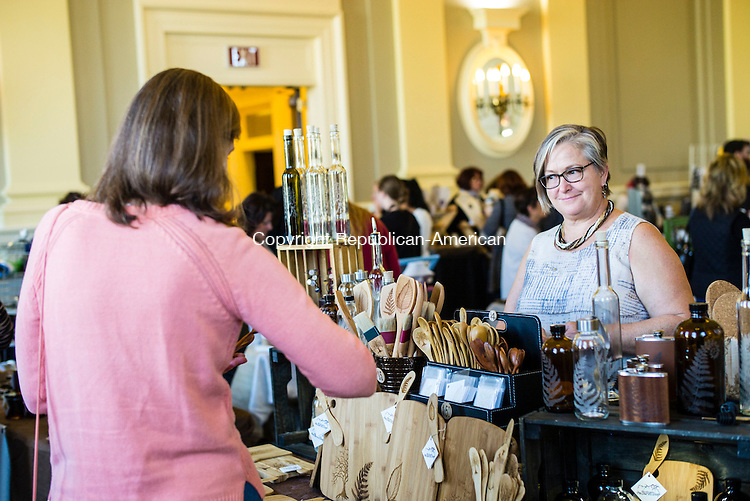 Waterbury, CT- 19 November 2016-111916CM02-  Margrit Morley of Watertown, left,  buys wooden spoons from Denise O'Reilly from The Burnt Shop of Glastonbury, during the 4th annual Waterbury Artisans Marketplace at City Hall in Waterbury on Saturday.  The event, sponsored by the Waterbury Public Art Committee,  featured food trucks and artisans from Waterbury and the surrounding area.  Christopher Massa Republican-American