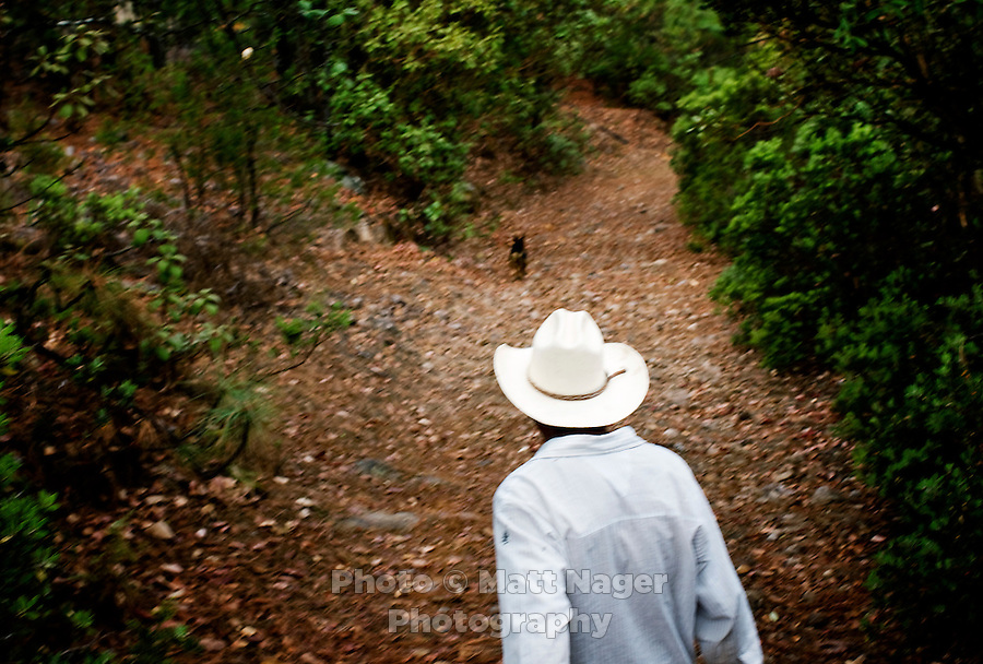 An apple orchard farmer and occasional tour guide walks his horse on a guide in Urique Canyon in Cerocahui, Mexico, Friday, June 20, 2008. While forestry and apple harvesting is traditional to Cerocahui, the tourist industry is growing rapidly...PHOTOS/ MATT NAGER