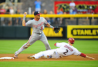 Jun. 2, 2011; Phoenix, AZ, USA; Washington Nationals shortstop Ian Desmond throws to first after forcing out Arizona Diamondbacks base runner Kelly Johnson in the first inning at Chase Field. Mandatory Credit: Mark J. Rebilas-