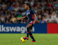 ORLANDO, FL - MARCH 05: Crystal Dunn #19 of the United States dribbles during a game between England and USWNT at Exploria Stadium on March 05, 2020 in Orlando, Florida.