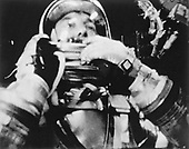 Cape Canaveral, FL - (FILE) Astronaut Alan B. Shepard photographed in flight by a 16mm movie camera inside the Freedom 7 spacecraft on Friday, May 5, 1961. Shepard is just about to raise the shield in front of his face during descent after opening of the main parachute..Credit: NASA via CNP