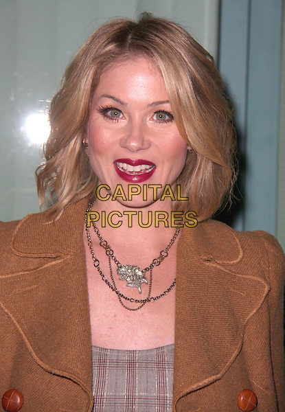 "CHRISTINA APPLEGATE .Academy Of Television Arts and Sciences Presents An Evening With ""Samantha Who?"" held at the Leonard H. Goldenson Theatre, North Hollywood, California, USA, 12th February 2009. .portrait headshot red lipstick necklace brown tweed coat grey gray plaid tartan checked.CAP/ADM/CH.©Charles Harris/AdMedia/Capital Pictures"