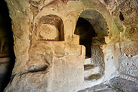 "Pictures & images of the interior font of the  Comlekci Church,  10th century, the Vadisi Monastery Valley, ""Manastır Vadisi"",  of the Ihlara Valley, Guzelyurt , Aksaray Province, Turkey.<br /> <br /> Comlekci Church is a Roman Byzantine church dating from the 10th century. the south section of the roof frescoes depict the Evangel, Christmas and the adoration of the magi. The northern panel frescoes depict Christ and the Cross."