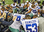 Some Dallas Cowboys and some St. Louis Rams gather for a prayer after the pre- season game between the St. Louis Rams and the Dallas Cowboys at the Cowboys Stadium in Arlington, Texas. Dallas defeats St. Louis  20 to 19.