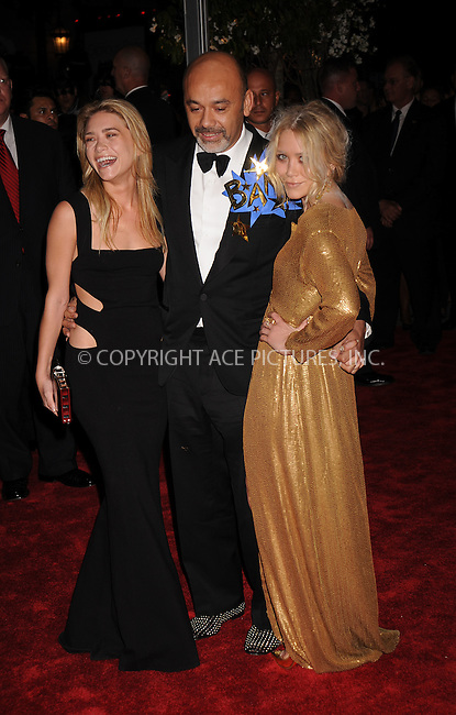 WWW.ACEPIXS.COM . . . . . ....May 5 2008, New York City....Actress Ashley Olsen, designer Christian Louboutin, and actress Mary Kate Olsen arriving at the Metropolitan Museum of Art Costume Institute Gala, Superheroes: Fashion and Fantasy, held at the Metropolitan Museum of Art on the Upper East Side of Manhattan.....Please byline: KRISTIN CALLAHAN - ACEPIXS.COM.. . . . . . ..Ace Pictures, Inc:  ..(646) 769 0430..e-mail: info@acepixs.com..web: http://www.acepixs.com