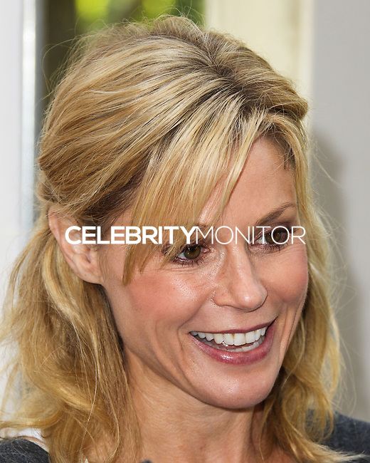 LOS ANGELES, CA, USA - APRIL 27: Julie Bowen at the Milk + Bookies 5th Annual Story Time Celebration held at the Skirball Cultural Center on April 27, 2014 in Los Angeles, California, United States. (Photo by Xavier Collin/Celebrity Monitor)