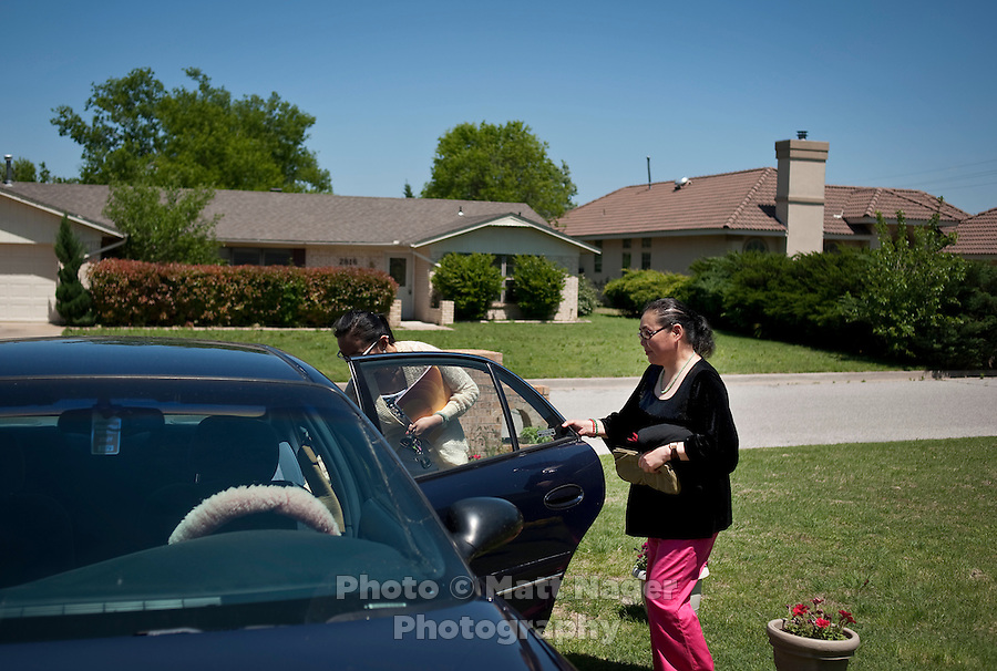 """Yue Zheng (cq) and her mother Dongping Yuan (cq, right) outside their temporary home in Lawton, Oklahoma, April 29, 2010. Zheng is teaching in the US as part of a """"guest teacher"""" program for two years and will soon be returning to her home in Henan province in China...PHOTO/ MATT NAGER"""