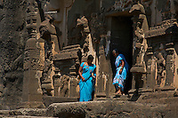 Kailash Temple at Ellora Caves Aurangabad, India.Kailash Temple, also Kailasa Temple is one of the 34 monasteries and temples, extending over more than 2†km, that were dug side by side in the wall of a high basalt cliff in the complex located at Ellora, Maharashtra, India. Of these 34 monasteries and temples, the Kailasa (cave 16) is a remarkable example of Indian rock-cut architecture on account of its striking proportion; elaborate workmanship architectural content and sculptural ornamentation.. It is designed to recall Mount Kailash, the abode of Lord Shiva[2]. While it exhibits typical Dravidian features, it was carved out of one single rock. It was built in the 8th century by the Rashtrakuta king Krishna I..The Kailash Temple is notable for its vertical excavation-carvers started at the top of the original rock, and excavated downward, exhuming the temple out of the existing rock. The traditional methods were rigidly followed by the master architect which could not have been achieved by excavating from the front. The architects found to design this temple were from the southern Pallava kingdom..