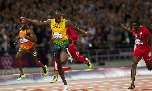05 AUG 2012 - LONDON, GBR - Usain Bolt (JAM) (second from left) of Jamaica wins the men's 100m final during the London 2012 Olympic Games athletics in the Olympic Stadium in Stratford, London, Great Britain (PHOTO (C) 2012 NIGEL FARROW)