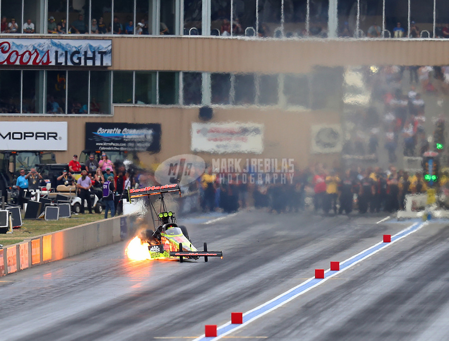 Jul 22, 2017; Morrison, CO, USA; NHRA top fuel driver Troy Coughlin Jr has an engine fire during qualifying for the Mile High Nationals at Bandimere Speedway. Mandatory Credit: Mark J. Rebilas-USA TODAY Sports