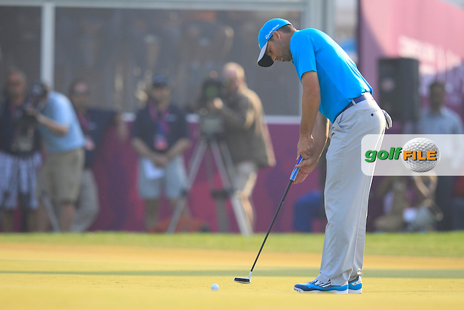 Sergio Garcia (ESP) takes his putt on the 18th green during Saturday's Final Round of the Commercial Bank Qatar Masters 2014 held at Doha Golf Club, Doha, Qatar. 25th January 2014.<br /> Picture: Eoin Clarke www.golffile.ie
