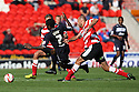 Anthony Grant of Stevenage is stopped by Rob Jones of Doncaster. Doncaster Rovers v Stevenage - npower League 1 -  Keepmoat Stadium, Doncaster - 22nd September, 2012. © Kevin Coleman 2012.