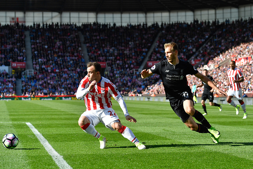 Stoke City's Xherdan Shaqiri battles with Liverpool's Ragnar Klavan<br /> <br /> Photographer Terry Donnelly/CameraSport<br /> <br /> The Premier League - Stoke City v Liverpool - Saturday 8th April 2017 - bet365 Stadium - Stoke-on-Trent<br /> <br /> World Copyright &copy; 2017 CameraSport. All rights reserved. 43 Linden Ave. Countesthorpe. Leicester. England. LE8 5PG - Tel: +44 (0) 116 277 4147 - admin@camerasport.com - www.camerasport.com