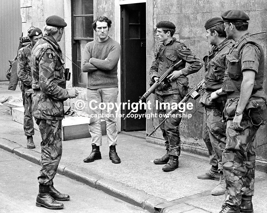 British soldiers quiz la young man in a follow-up arms search in the Markets area of Belfast, N Ireland, after an all-night gun battle. The upsurge in violence was triggered by the introduction of internment. 197108090384c..Copyright Image from Victor Patterson, 54 Dorchester Park, Belfast, United Kingdom, UK...For my Terms and Conditions of Use go to http://www.victorpatterson.com/Victor_Patterson/Terms_%26_Conditions.html