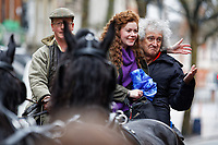 Pictured: Brian May on a horse cart poses with a fan. Thursday 26 December 2019<br /> Re: Guitarist Brian May of Queen has joined the Boxing Day Hunt in Wind Street, Swansea, Wales, UK.