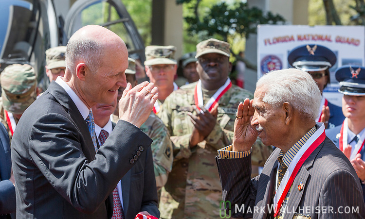 "Florida Governor Rick Scott salutes 92 year old veteran Bennie Covington, from New Port Richey, with the Governor's Veteran Service Award during the Florida Department of Military Affairs and the Florida National Guard sponsored ""Florida National Guard Day"" at the Capitol"