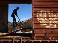NWA Democrat-Gazette/BEN GOFF @NWABENGOFF<br /> A rider passes through the railroad box car feature on the intermediate slopestyle line on Saturday Nov. 7, 2015 during opening day of The Railyard bike park in Rogers.