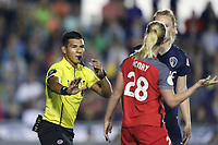 Cary, NC - Saturday April 22, 2017: Referee Victor Rivas steps between Amandine Henry (28) and Samantha Mewis (behind) during a regular season National Women's Soccer League (NWSL) match between the North Carolina Courage and the Portland Thorns FC at Sahlen's Stadium at WakeMed Soccer Park.