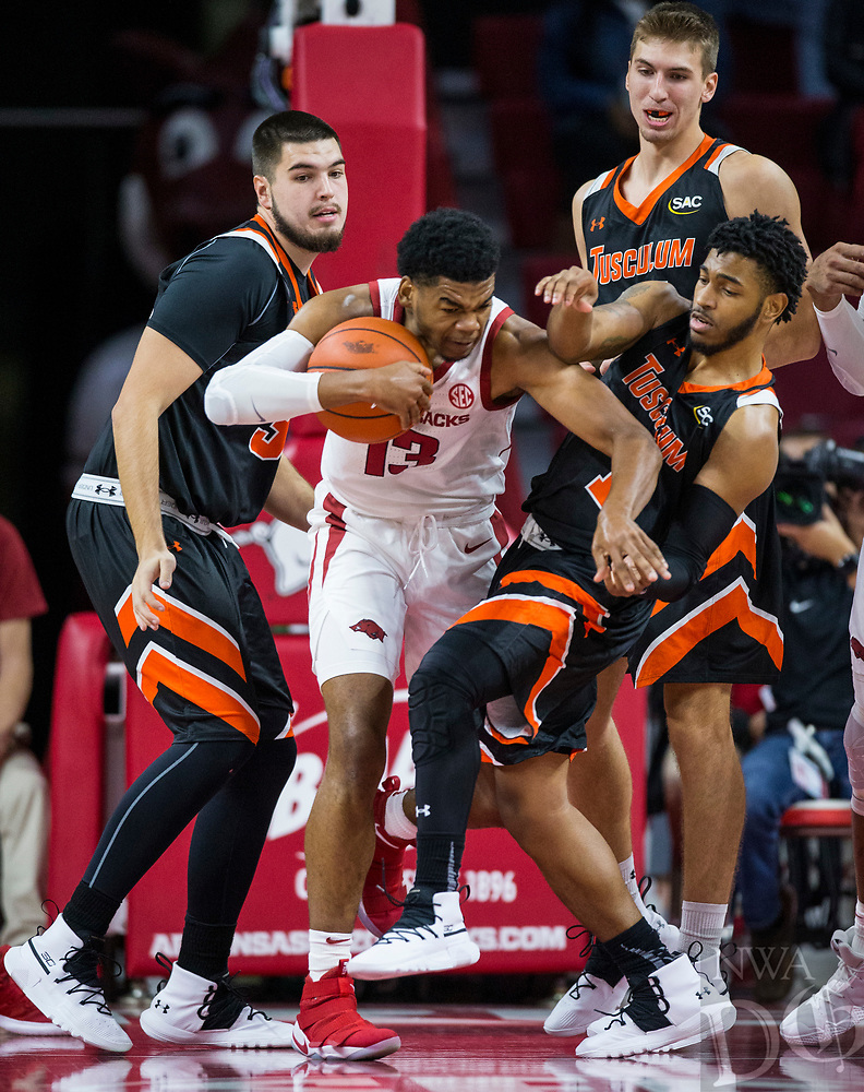 NWA Democrat-Gazette/BEN GOFF @NWABENGOFF <br /> Mason Jones (13) of Arkansas steals the ball from Tariq Jenkins (1) of Tusculum in the first half Friday, Oct. 26, 2018, during an exhibition game in Bud Walton Arena in Fayetteville.