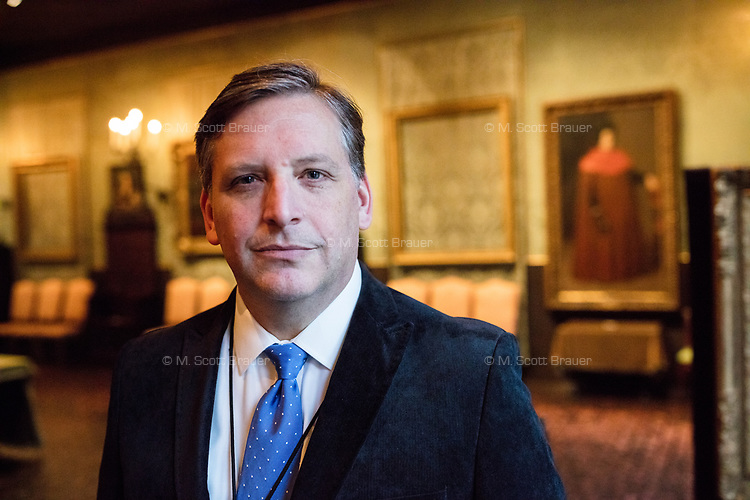 """Anthony Amore is the Directory of Security and Chief Investigator at the Isabella Stewart Gardner Museum in Boston, Mass., USA, seen here in The Dutch Room at the museum on Tues., Dec. 5, 2017. Part of Amore's ongoing work is the investigation into the 1990 theft of 13 pieces from the museum: 10 paintings, 2 objects, and 1 etching. Among the paintings stolen were works by Rembrandt, Vermeer, Degas, and Manet. The large empty frame on the wall is what held Rembrandt's """"The Storm on the Sea of Galilee"""" painting until it was stolen from the museum in the heist."""