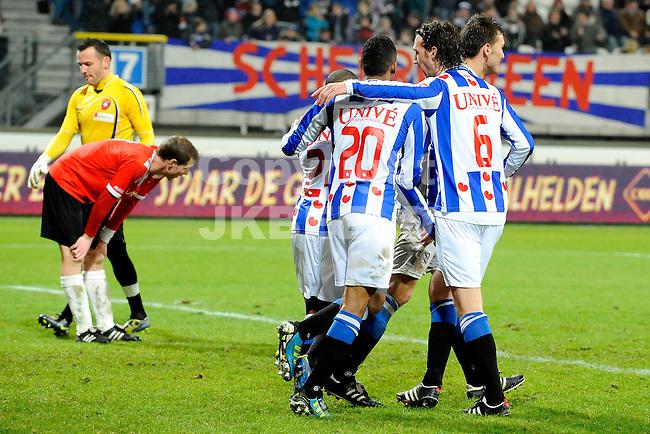 HEERENVEEN - Voetbal, SC Heerenveen - FC Oss, knvb beker,  Abe Lenstra stadion, seizoen 2011-2012, 21-12-2011 Heerenveen viert een treffer terwijl FC Oss treurt.