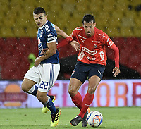 BOGOTA - COLOMBIA, 04-08-2018: Jhon Duque Arias (Izq) jugador de Millonarios disputa el balón con Jean Carlos Blanco (Der) jugador de Deportivo Independiente Medellín durante partido por la fecha 3 de la Liga Águila II 2018 jugado en el estadio Nemesio Camacho El Campin de la ciudad de Bogotá. / Jhon Duque Arias (L) player of Millonarios fights for the ball with Jean Carlos Blanco (R) player of Deportivo Independiente Medellin during the match for the date 3 of the Liga Aguila II 2018 played at the Nemesio Camacho El Campin Stadium in Bogota city. Photo: VizzorImage / Gabriel Aponte / Staff.