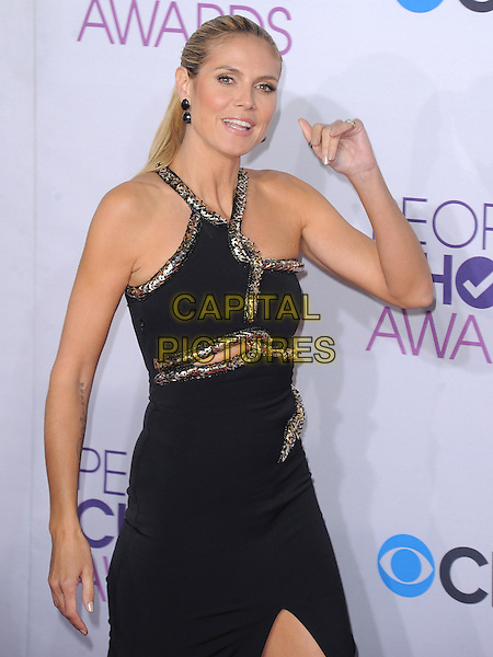 Heidi Klum.The 2013 People's Choice Awards held at Nokia Live in Los Angeles, California 9th January 2013                                                                   .half length dress black silver gold trim cut out away tattoo hand arm waving .CAP/DVS.©DVS/Capital Pictures.