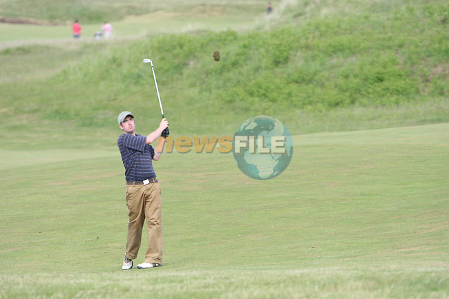 Mark Sheridan of Old Conna Golf Club hitting onto the 3rd green on day 2 of the 2010 East of Ireland Amateur Golf Competition in Co.Louth Golf Club...Photo NEWSFILE/Jenny Matthews.(Photo credit should read Jenny Matthews/NEWSFILE)....This Picture has been sent you under the condtions enclosed by:.Newsfile Ltd..The Studio,.Millmount Abbey,.Drogheda,.Co Meath..Ireland..Tel: +353(0)41-9871240.Fax: +353(0)41-9871260.GSM: +353(0)86-2500958.email: pictures@newsfile.ie.www.newsfile.ie.FTP: 193.120.102.198.